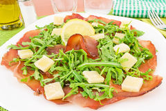 Bresaola, arugula with shaved Parmesan Royalty Free Stock Photos