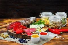 Bresaola curado cortado com especiarias e um ramo dos alecrins imagem de stock royalty free
