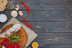 Bresaola curado cortado com especiarias e um ramo dos alecrins fotografia de stock royalty free