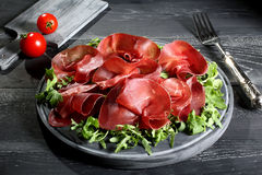 Bresaola on cutting board Stock Photo