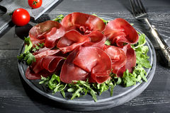 Bresaola on cutting board Stock Images
