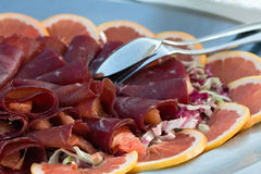 Bresaola and fruit Royalty Free Stock Photography