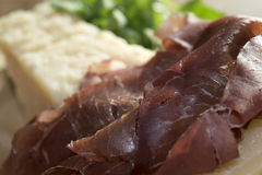 Bresaola and parmesan Stock Images