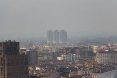 Brescia cityscape, buildings in fog, Lombardy, Italy stock images