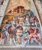 Brescia - freskomålningen av Martyrium av St Barbara i kyrkliga Chiesa del Santissimo Corpo di Cristo Arkivbild