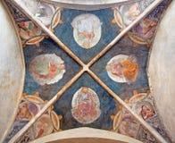 BRESCIA, ITALIA, 2016: L'affresco del soffitto di quattro evangelisti e medici della chiesa latina Fotografie Stock