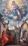 BRESCIA ITALIEN: Den måla Madonna med helgonen Francis av Assisi, John evangelisten och St Jerome och biskop Honorius Royaltyfri Foto