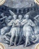BRESCIA ITALIEN, 2016: Den monochromatic freskomålningen av den första kristen spelar martyr bland lejonen i colosseum Arkivbilder