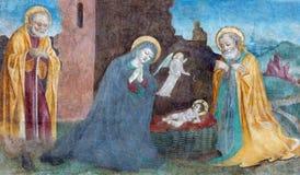 BRESCIA ITALIEN: Kristi födelsefreskomålning av Paolo da Caylina il Vecchio circa 1501 i kyrkliga Chiesa del Santissimo Corpo di  Arkivfoton