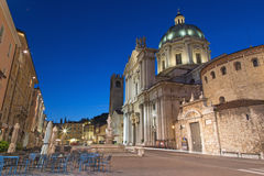 BRESCIA, ITALY, 2016: The Dom at evening dusk (Duomo Nuovo and Duomo Vecchio). Royalty Free Stock Image