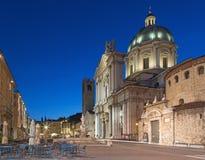 BRESCIA, ITALY, 2016: The Dom at evening dusk (Duomo Nuovo and Duomo Vecchio). Stock Photos