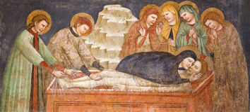 BRESCIA, ITALY, 2016: The gothic fresco of Burial of Jesus in church Chiesa di San Francesco d'Assisi by unknown artist. BRESCIA, ITALY - MAY 22, 2016: The Stock Photography