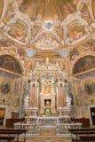 BRESCIA, ITALY, 2016: The main altar and the frescoes of cardinal virtues  in Chiesa di Santa Maria della Carita Royalty Free Stock Image