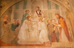 BRESCIA, ITALY - MAY 21, 2016: The fresco of Baptism and Communion in church Chiesa di San Pietro in Olvieto Stock Photos