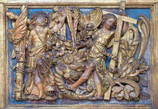 BRESCIA, ITALY, 2016: The polychrome baroque relief of angels withe the cross in church Chiesa di San Giovanni Evangelista Stock Images