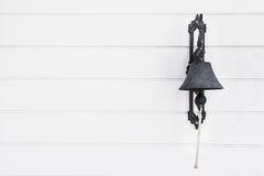 Bress bell on wall. Stock Photo