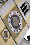 Bressanone belltower - Italy. Details of the clock and the window of the Bressanone belltower -Italy Stock Photo
