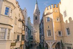 Bressanone downtown with buildings and White Tower. Royalty Free Stock Photography