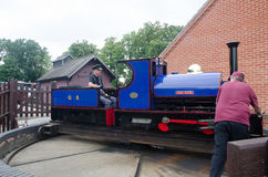 Narrow gauge railway train being pushed on turntable Stock Images