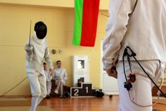 Fencing competitions among young boys and girls royalty free stock image