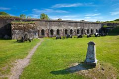 Brest, Belarus - May 12, 2015: The Fifth Fort of Brest Fortress. Old canons near building. Stock Image