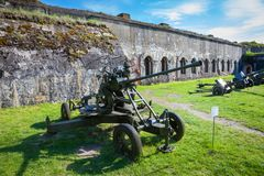 Brest, Belarus - May 12, 2015: The Fifth Fort of Brest Fortress. Old guns in the foreground. Brest, Belarus - May 12, 2015: The Fifth Fort of Brest Fortress in Stock Photos