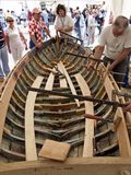 Restoration of an old wooden boat. Brest, France - July 14, 2008: Croatian traditional shipbuilders are working on the restoration of an old wooden boat during Stock Photo