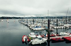 Brest, France 31 May 2018 Panoramic outdoor view of sete marina. Many small boats and yachts aligned in the port. Calm water and blue cloudy sky royalty free stock photography