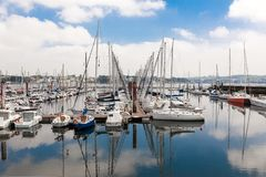 Brest, France 28 May 2018 Panoramic outdoor view of sete marina Many small boats and yachts aligned in the port. Calm water and bl. Ue cloudy sky stock images