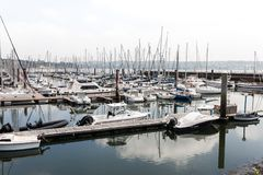 Brest, France 28 May 2018 Panoramic outdoor view of sete marina Many small boats and yachts aligned in the port. Calm water and bl. Ue cloudy sky royalty free stock photos