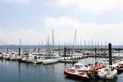 Brest, France 28 May 2018 Panoramic outdoor view of sete marina Many small boats and yachts aligned in the port. Calm water and bl. Ue cloudy sky stock photography
