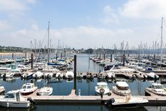 Brest, France 28 May 2018 Panoramic outdoor view of sete marina Many small boats and yachts aligned in the port. Calm water and blue cloudy sky royalty free stock images