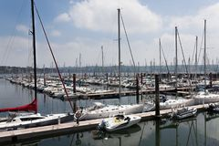 Brest, France 28 May 2018 Panoramic outdoor view of sete marina Many small boats and yachts aligned in the port. Calm water and bl. Ue cloudy sky stock photos