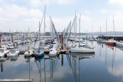 Brest, France 28 May 2018 Panoramic outdoor view of sete marina Many small boats and yachts aligned in the port. Calm water and blue cloudy sky stock photo