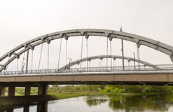 Brest, Republic of Belarus - Old arch metallic bridge of gray color across the river Brest republic Belarus-may 2016 Stock Photography