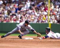 Bret Boone and Kevin Millar. Red Sox baserunner Kevin Millar asks for timeout while Mariners 2B Bret Boone looks for the umpires signal after he tags out Millar Royalty Free Stock Photography
