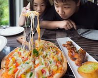Brethren eat a pizza togather in restaurant. Food, family and child concept Stock Images