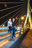 Brethren talk to her on the bridge, smiling and happy.  stock image