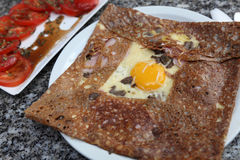 Breton galette. Image of a buckwheat flour pancake containing egg,ham,mushroom and cheese.Such food is specific for the entire France mostly in Normandy and Royalty Free Stock Photos