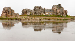 Breton house between rocks Royalty Free Stock Image