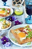 Breton traditional pancake made from buckwheat flour with ham, cheese, egg, feta, green peas and green butter. Breakfast of buckwh stock photos