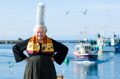 Breton women with headdress. Breton woman with headdress on a harbor in brittany royalty free stock photo
