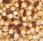 Brett smör på popcorn för kolamandeljordnöt royaltyfri bild