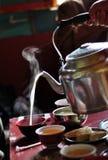 Brett smör på te Arkivfoto