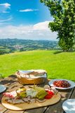 Brettljause with view over meadow to south styrian wine route Stock Photo