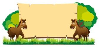 Brettschablone mit zwei Pferden Stockfotos
