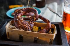 Bretzel in a basket and beer. German cuisine stock image