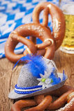 Bretzels and beer. German bretzels and beer on wooden table Stock Photo