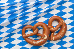Bretzels. On a blue checkered fabric background Stock Images