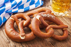 Bretzels. German bretzels and beer on wooden table Royalty Free Stock Photo